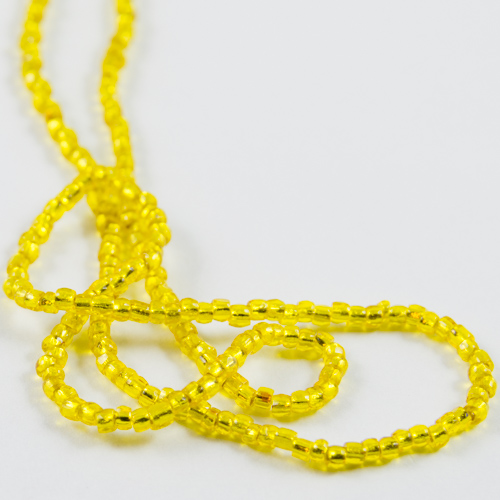 0134 12/0 3-cut bead transparent yellow with silver core