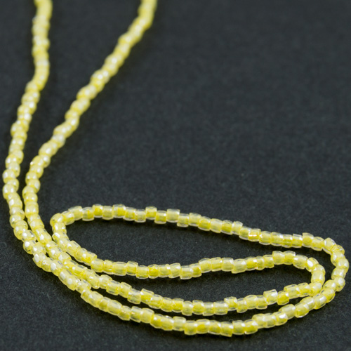 0161 12/0 3-cut bead transparent with yellow core