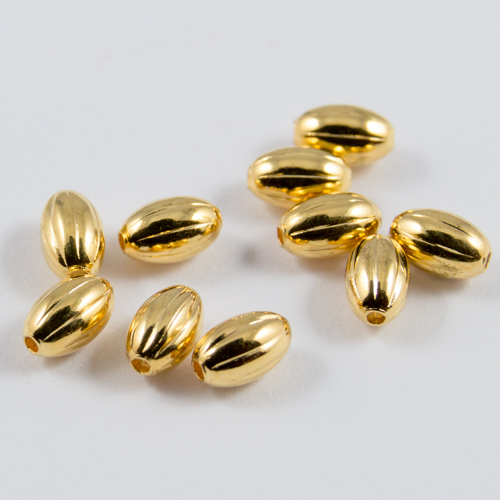 Gilt oval corrugated beads 5x3mm
